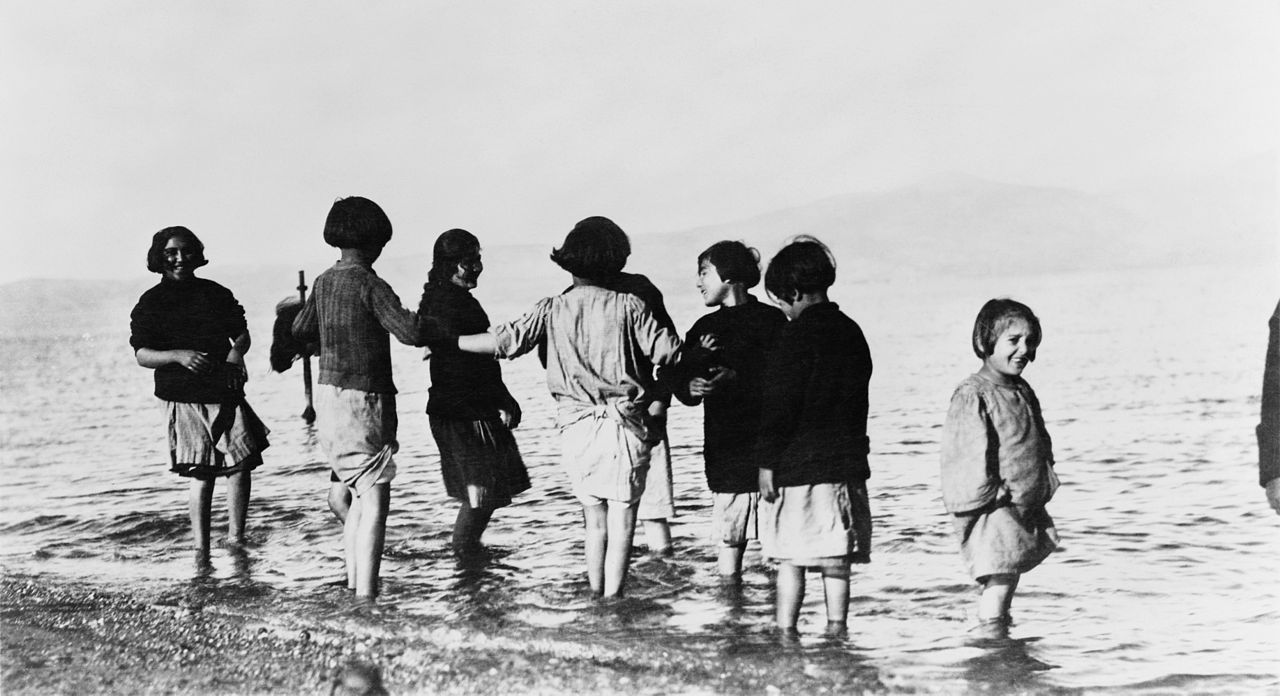1280px-Greek_and_Armenian_refugee_children_in_the_sea_near_Marathon,_Greece,_c._1915